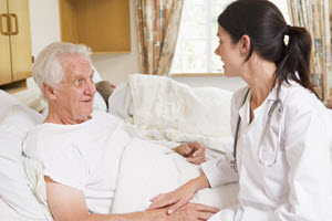 Doctor talking to elderly patient